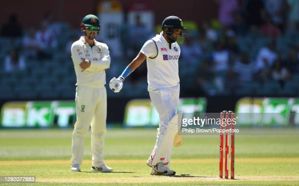Mohammed Shami of India decides against batting further after being taped up on his right arm during day three of the First Test match between...