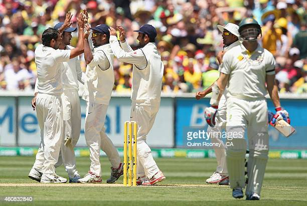 Mohammed Shami of India is congratulated by team mates after dismissing Chris Rogers of Australia during day one of the Third Test match between...