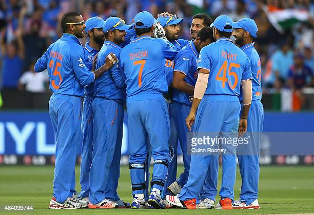 Mohammed Shami of India is congratulated by team mates after taking the wicket of Quinton de Kock of South Africa during the 2015 ICC Cricket World...