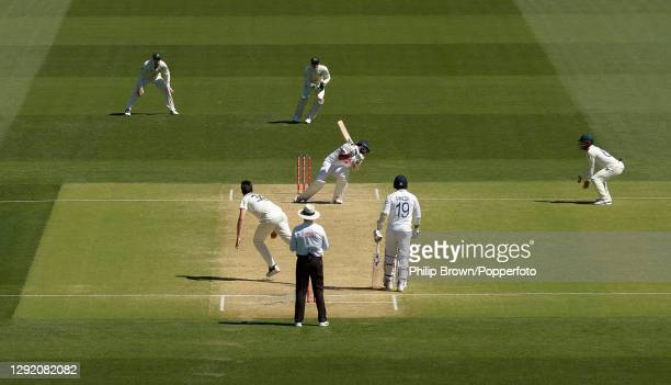 Mohammed Shami of India is hit on the arm by a delivery bowled by Pat Cummins of Australia and the India innings finishes during day three of the...