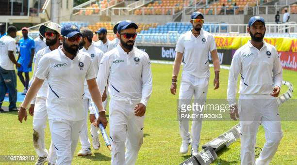 Mohammed Shami Virat Kohli Ishant Sharma and Cheteshwar Pujara of India walk off the field after winning on day 4 of the 2nd Test between West Indies...