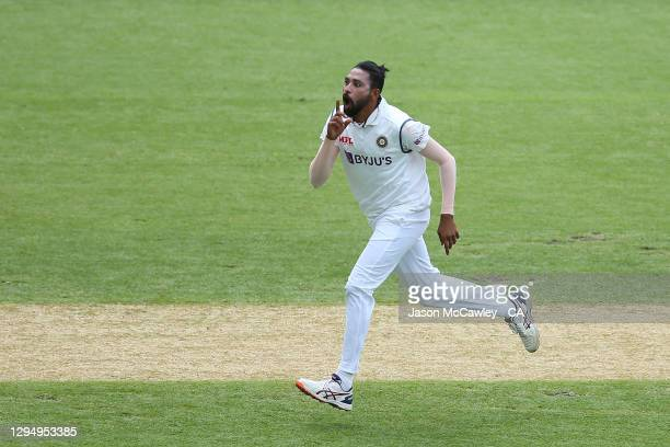 Mohammed Siraj of India celebrates after taking the wicket of David Warner of Australia during day one of the 3rd Test match in the series between...