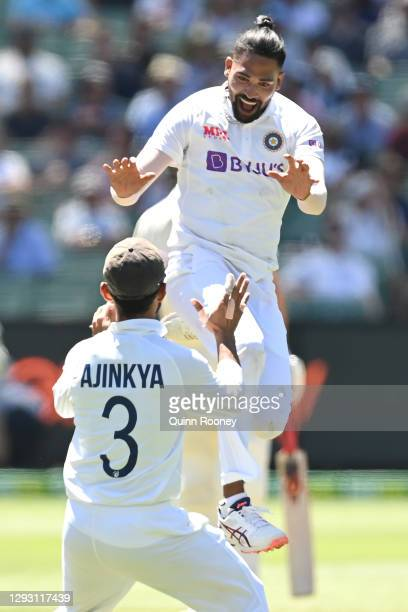 Mohammed Siraj of India celebrates getting the wicket of Marnus Labuschagne of Australia during day one of the Second Test match between Australia...