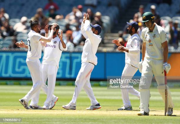 Mohammed Siraj of India celebrates taking the wicket of Cameron Green of Australia during day four of the Second Test match between Australia and...