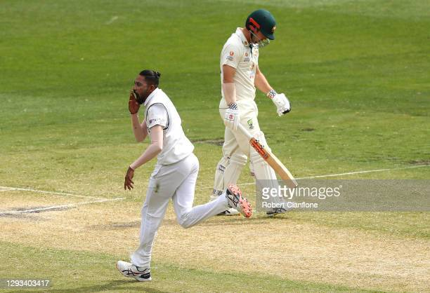 Mohammed Siraj of India celebrates taking the wicket of Travis Head of Australia during day three of the Second Test match between Australia and...
