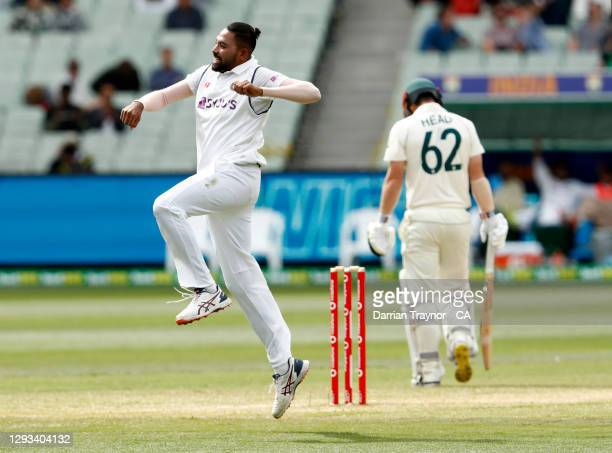 Mohammed Siraj of India celebrates the wicket of Travis Head of Australia during day three of the Second Test match between Australia and India at...