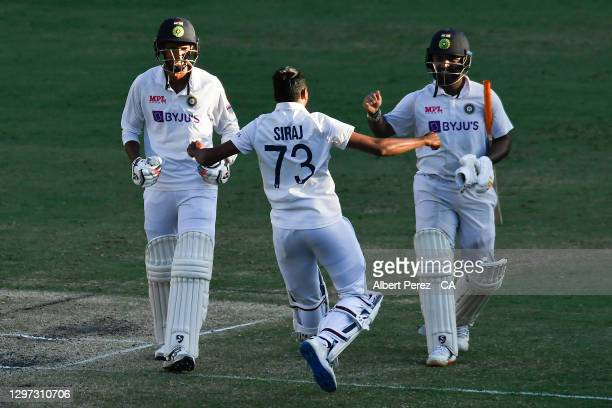 Mohammed Siraj of India runs to the field to celebrate with Rishabh Pant and Navdeep Saini after his team's victory during day five of the 4th Test...
