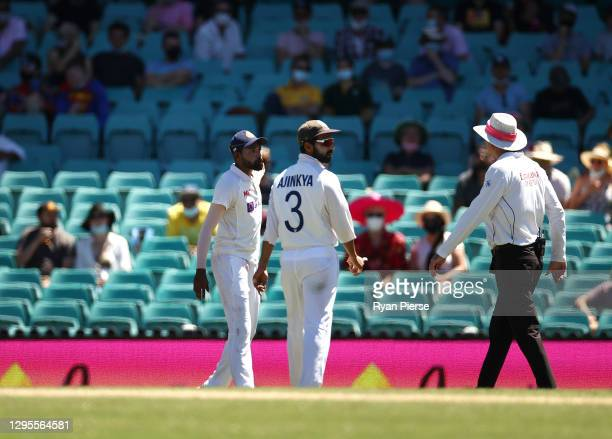 Mohammed Siraj of India speaks to the umpires after an alleged abusive comment was directed at him from the crowd during day four of the Test match...