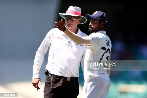 Mohammed Siraj of India stops play to make a formal complaint to Umpire Paul Reiffel about some spectators in the bay behind his fielding position...