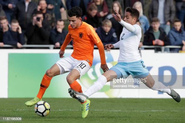 Mohammed Taabouni of Holland U17 Tamir Nes Arbel of Israel U17 during the match between Holland U17 v Israel U17 at the Sportpark Zegersloot on March...