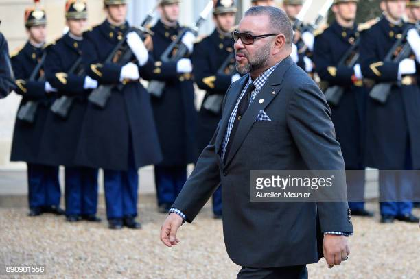 Mohammed VI of Morocco arrives for a meeting with French President Emmanuel Macron as he receives the One Planet Summit's international leaders at...