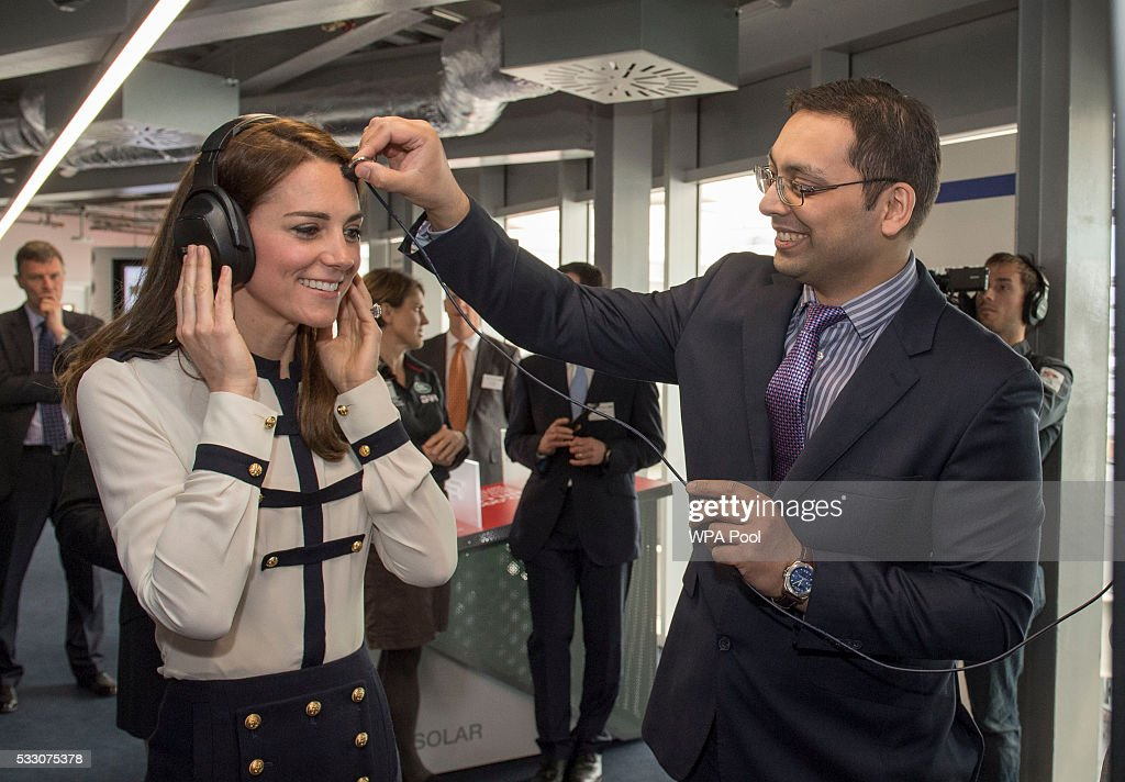 Mohammed-Asif Akhmad from BAE Systems places a microphone on Catherine, Duchess of Cambridge, patron of the 1851 Trust, as she tours the new 'Tech Deck' Education Centre during her visit to the Land Rover BAR team, who are challenging for the 2017 America's Cup, on May 20, 2016 in Portsmouth, England. The Duchess of Cambridge is launching the 1851 Trust's two sailing projects and meeting people involved in the project. Afterwards she will open the 'Tech Deck' Education Centre at the heart of the base.