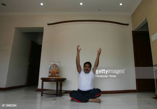 Mohan Rawle practices Yoga at his residence in Shivaji Park to keep himself fit for upcoming lok sabha election He is captian of parliment cricket...