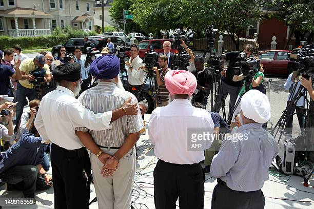 Mohan Singh Khatra speaks to the press at the Sikh Cultural Center in Richmond Hill in the New York borough of Queens on August 6 2012 Khatra's uncle...