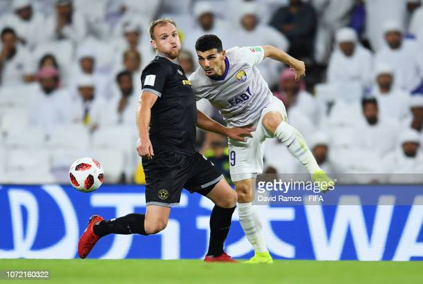 Mohanad Salem of Al Ain and Hamish Watson of Team Wellington battle for the ball during the FIFA Club World Cup first round playoff match between Al...