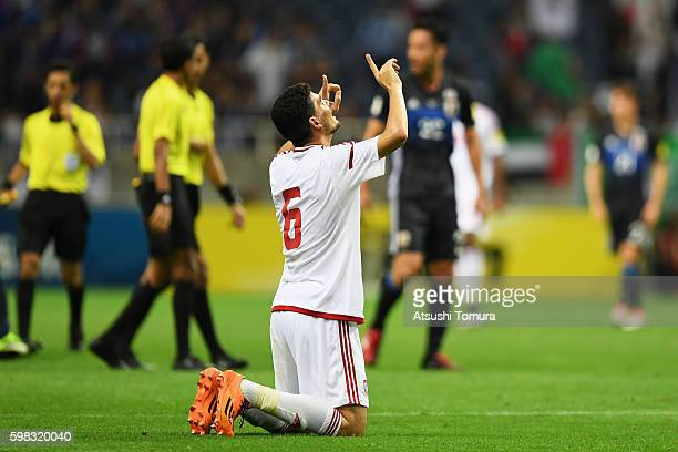 Mohanad Salem of the United Arab Emirates celebrates his team's 21 win in the 2018 FIFA World Cup Qualifier Final Round Group B match between Japan...