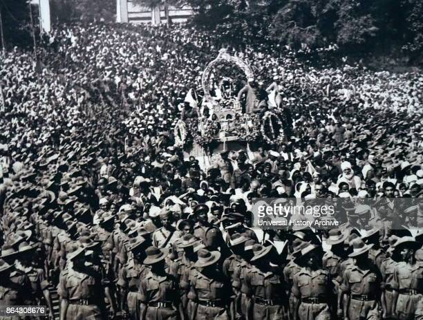 Mohandas Karamchand Gandhi at his cremation following his assassination in 1948 Gandhi was the preeminent leader of the Indian independence movement...