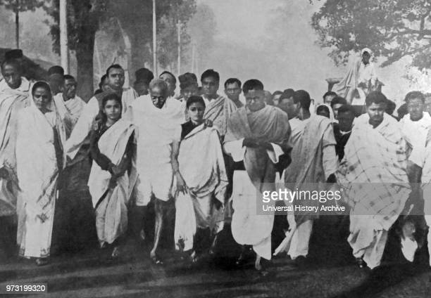 Mohandas Karamchand Gandhi with supporters on a Peace March during the Partition period following Indian Independence 1947 Gandhi was the preeminent...