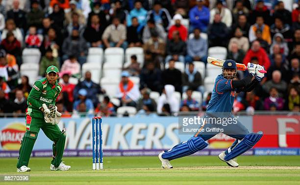 Mohandra Singh Dhoni of India hits out during the ICC Twenty20 World Cup match between India and Bangladesh at Trent Bridge on June 6, 2009 in...