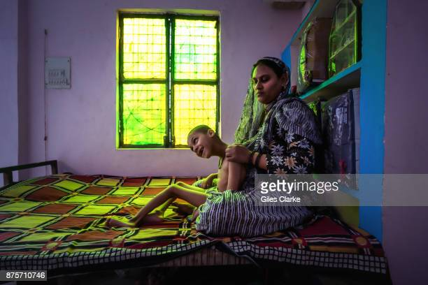 Mohd Anas 7 years old with his mother Kherunnisa at home in the Nawab Colony neighborhood Mohd was born to parents contaminated by a carcinogenic and...