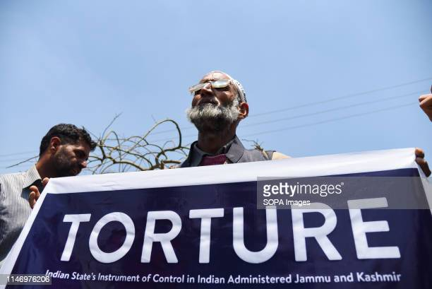 Mohd Qalander Khatana holds a banner during a Protest in Srinagar The Association of Parents of Disappeared Persons is observing the International...