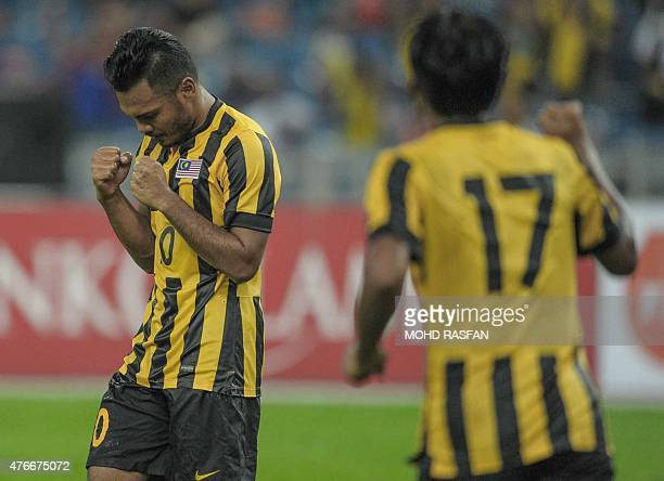 Mohd Safee Sali of Malaysia celebrates a goal with a teammate against East Timor during their 2018 World Cup qualifying Group A football match in...