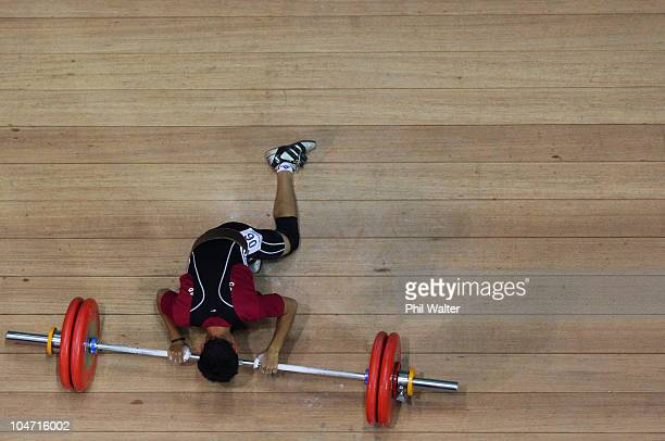 Mohd Shafiq Ismail of Malaysia reacts after an attempt in the Mens 56 kg weightlifting final during day one of the Delhi 2010 Commonwealth Games at...