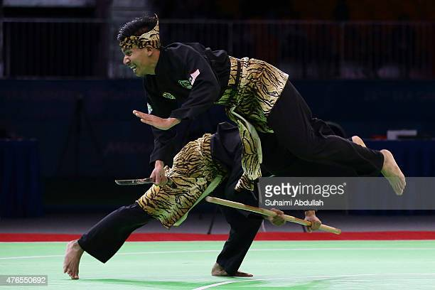 Mohd Taqiyuddin Hamid and Rosli Mohd Sharif of Malaysia compete in the pencak silat mensÕs ganda final at Expo Hall 2 during the 2015 SEA Games on...