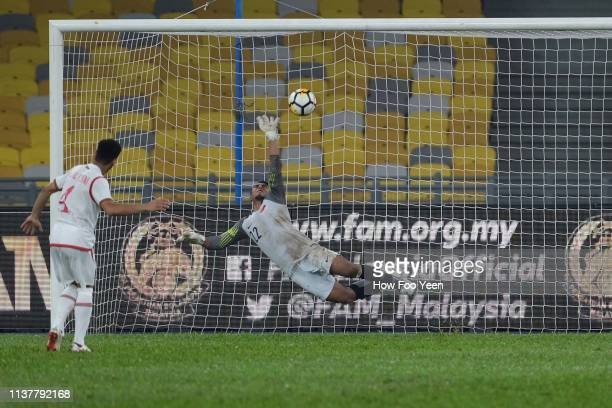 Mohdmmed Khasib Sulaiyam of Oman in action during penalty shootout with Zairul Nizam of Singapore during the Airmarine Cup final between Singapore...