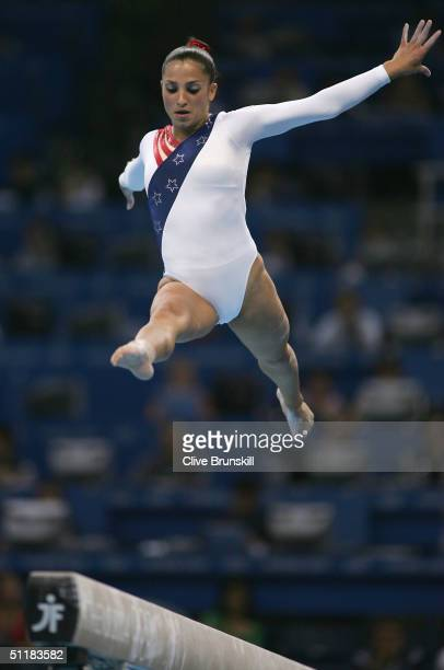 Mohini Bhardwaj of the United States competes in the beam in the women's artistic gymnastics team final uneven on August 17 2004 during the Athens...