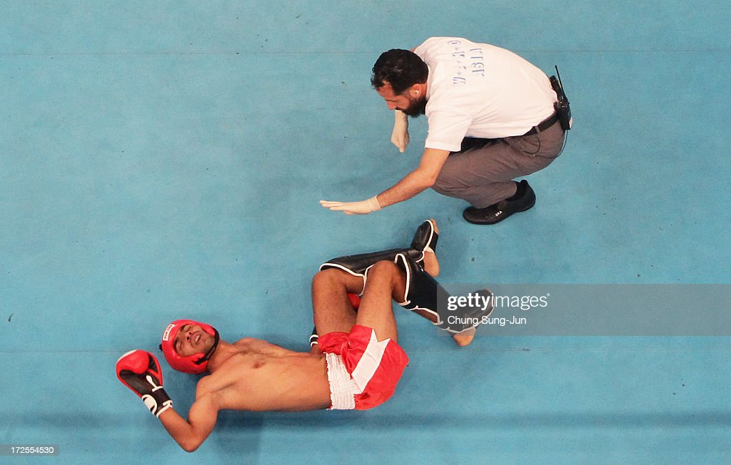Mohit Bhardwaj of Independent Olympic Athletes (AOI) lies on the mat after being knocked down by Fozili Odil of Tadzhikistan in the Kickboxing, Full Contact Men's 63.5kg Round of 16 at Dowon Gymnasium during day five of the 4th Asian Indoor Martial Arts Games on July 3, 2013 in Incheon, South Korea.