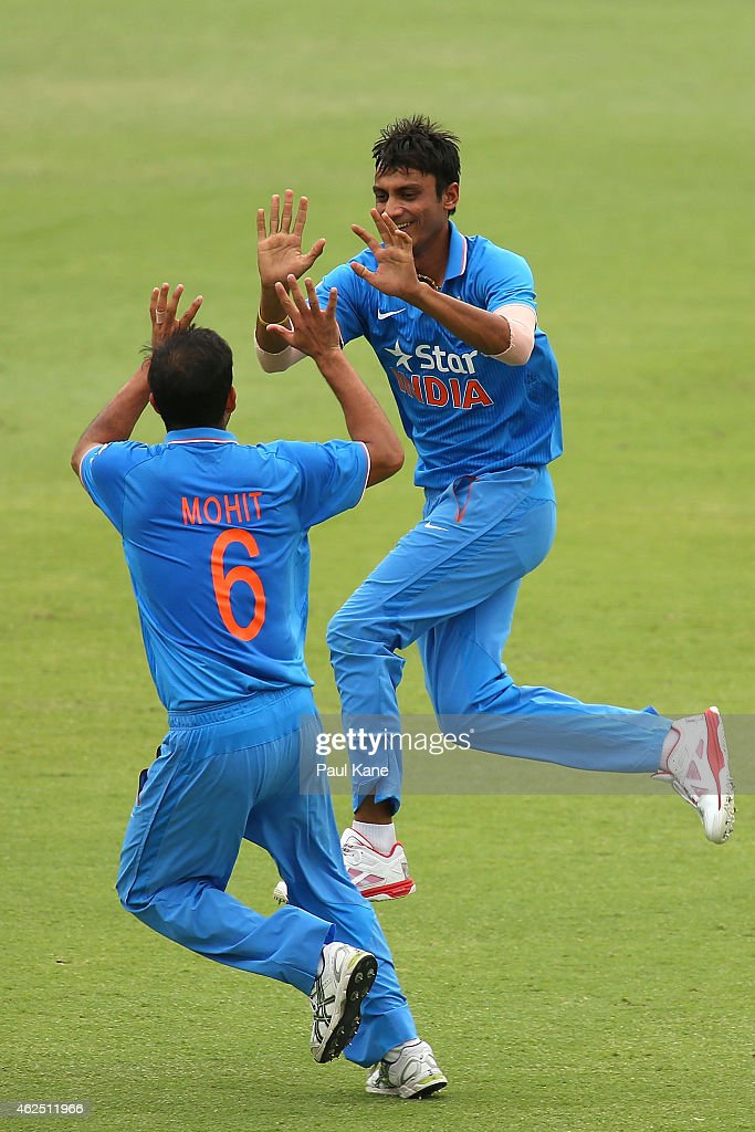 Mohit Sharma and Axar Patel of India celebrate the wicket of Moeen Ali of England during the One Day International match between England and India at the WACA on January 30, 2015 in Perth, Australia.