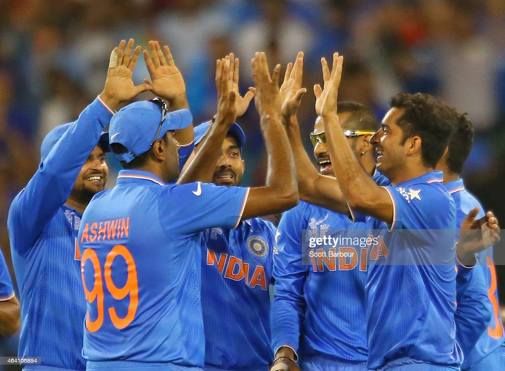 Mohit Sharma of India celebrates with his teammates after running out AB de Villiers of South Africa during the 2015 ICC Cricket World Cup match between South Africa and India at Melbourne Cricket Ground on February 22, 2015 in Melbourne, Australia.