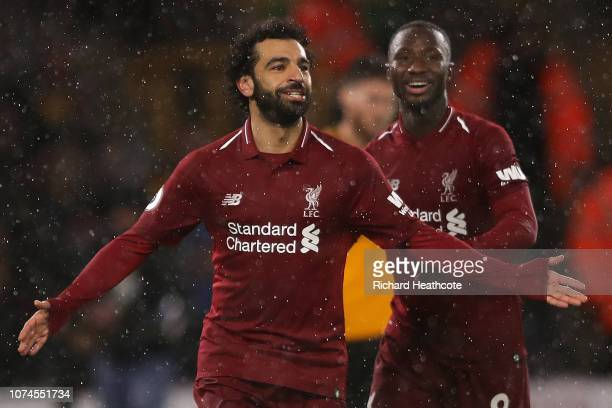 Mohmed Salah of Liverpool celebrates scoring the opening goal of the game during the Premier League match between Wolverhampton Wanderers and...
