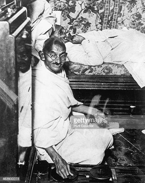 Mohondas Karamchand Gandhi known as Mahatma Indian Nationalist leader Here he is working at his spinning wheel a symbolic task he performed almost...