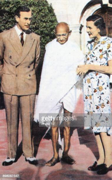 Mohondas Karamchand Gandhi known as Mahatma Indian Nationalist leader Here he stands between Lord and Lady Mountbatten