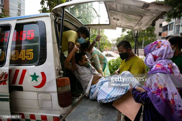 Mohosin Parvez, who has COVID-19, is transferred to a different hospital after the ICU at the hospital he was admitted to was full, on July 25, 2021...