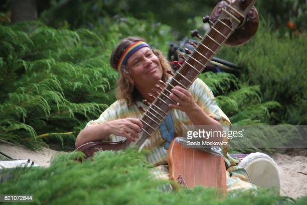 Mohsen Namjoo performs on the sitar at the Cosmic LongHouse Benefit at LongHouse Reserve on July 22 2017 in East Hampton New York