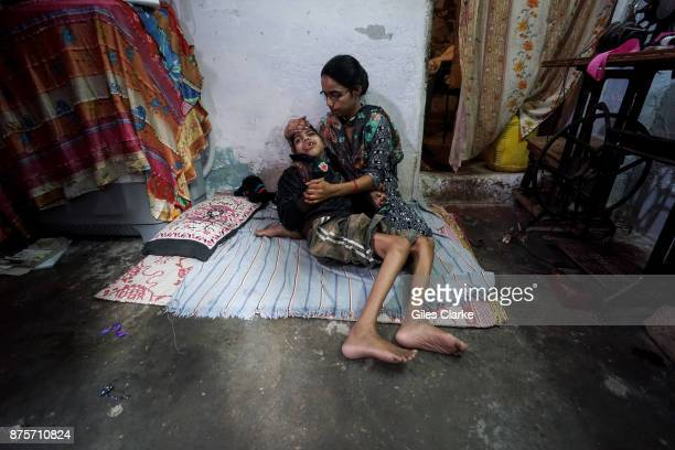 Mohsin 18 years old with his mother Nazneen at home in the Bag Umrao Dulha neighborhood Mohsin was born to parents contaminated by a carcinogenic and...