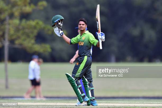 Mohsin Khan of Pakistan celebrates his century during the ICC U19 Cricket World Cup Warm Up Match between Pakistan and Namibia at Hagley Park on...