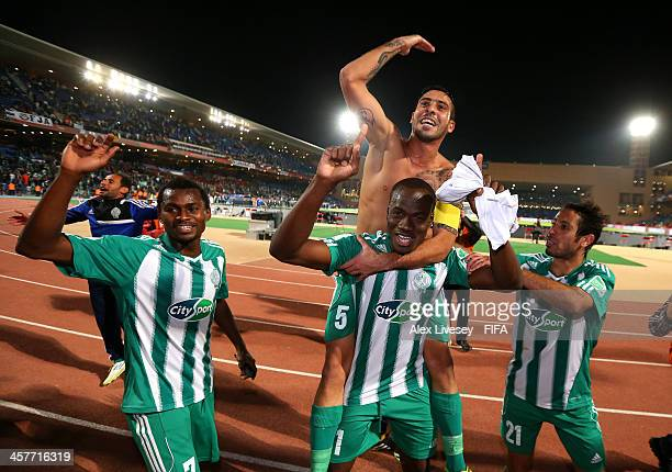 Mohsine Moutaouali Idrissa Coulibaly and Deo Kanda of Raja Casablanca celebrate after victory over Atletico Mineiro in the FIFA Club World Cup Semi...