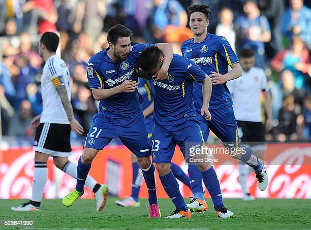 Moi Gomez and Alvaro Medran of Getafe celebrate after their team scored their 2nd goal during the La Liga match between Getafe CF and Valencia CF at...