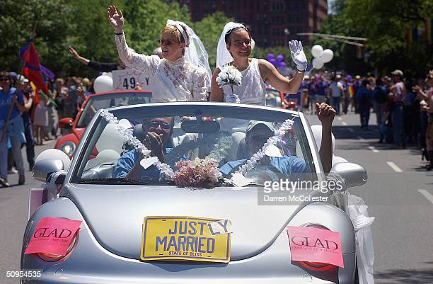 Moira Barrett and Johanna Schulman, of Cambridge, ride in a car on June 12, 2004 during the 34th annual Boston Gay Pride Parade in Boston,...