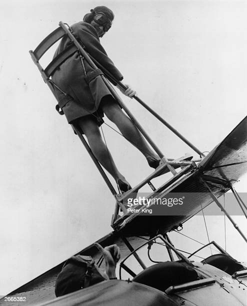 Moira Boyd a British European Airways stewardess strapped onto the wing of a Tiger Moth biplane at Wycombe Air Park during a rehearsal for an airshow