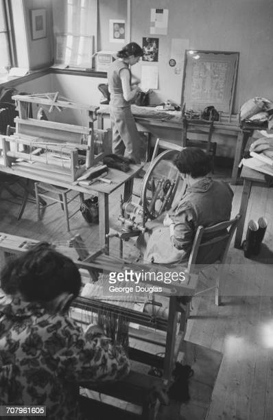 Moira Duncan Marian Gracie and Margaret Kirkland spinning yarn and weaving fabric in preparation for a student fashion show for charity held at the...