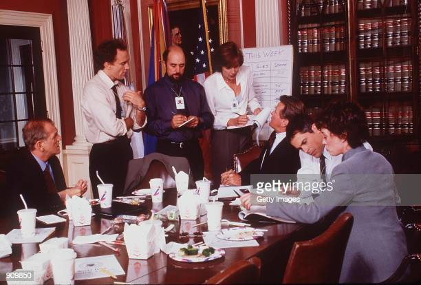"""Moira Kelly, Dule Hill, Rob Lowe, Richard Schiff, Martin Sheen, John Spencer, Allison Janney, and Bradley Whitford in """"The West Wing."""" Photo NBC"""