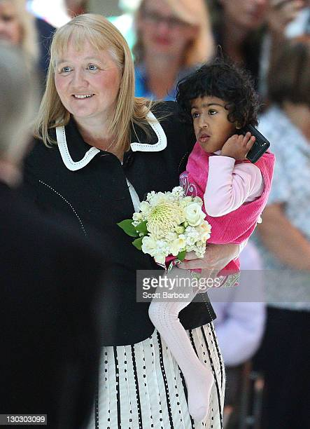 Moira Kelly holds previously conjoined twin Krishna as they meet Queen Elizabeth II at the new Royal Children's Hospital on October 26 2011 in...