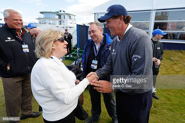 Moira Salmond the wife of Alex Salmond greets Phil Mickelson of the United States during the second round of the AAM Scottish Open at Castle Stuart...