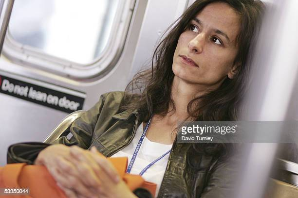 Moira Sauvane rides a train to work as a cancer researcher at Columbia University May 24, 2005 in New York City. Javier Garcia, an...