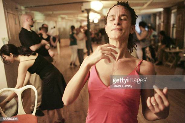 Moira Sauvane takes a break after dancing the tango at Triangulo June 7, 2005 in New York City. Javier Garcia, an Argentinian-American and a...